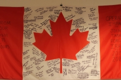 Canadian Flag Signed by Canadian Troops Deployed in Iraq and Kuwait on Operation IMPACT (1 of 2)